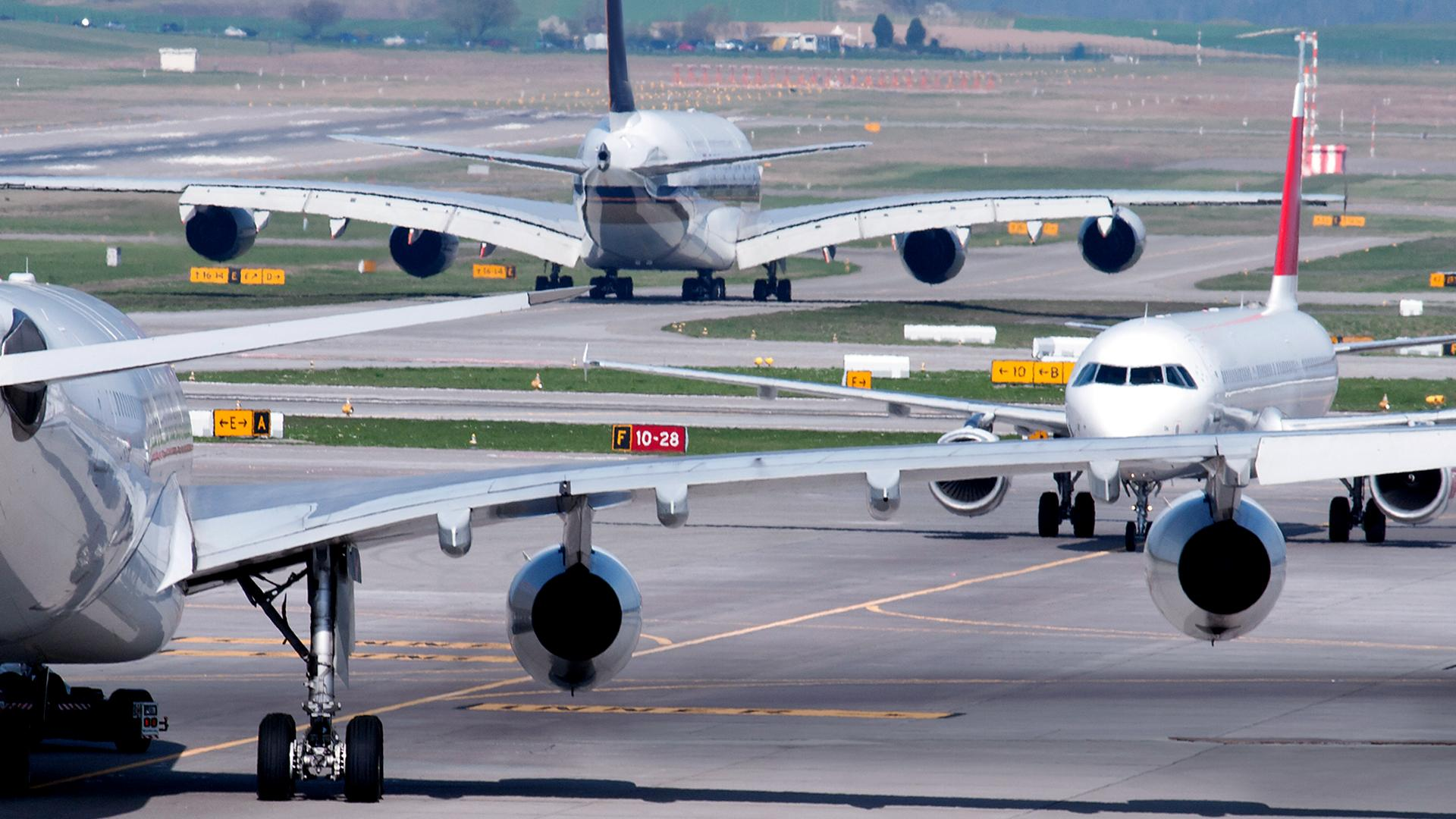Airplanes at a busy airport