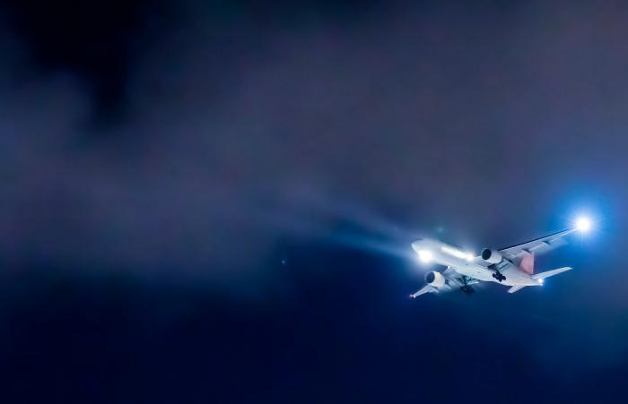 An airplane flying in the night sky