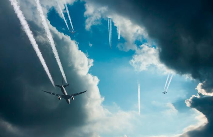 More than one airplanes and contrail