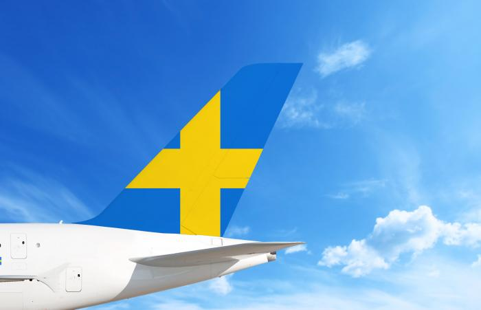 Airplane with Swedish flag on the tail