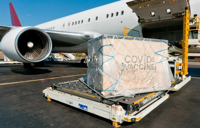 Airplane loaded with a pallet of COVID-19 vaccines